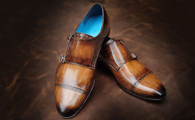 Hand made elements provide the finishing touch to Dominique Saint Paul shoes and leather goods